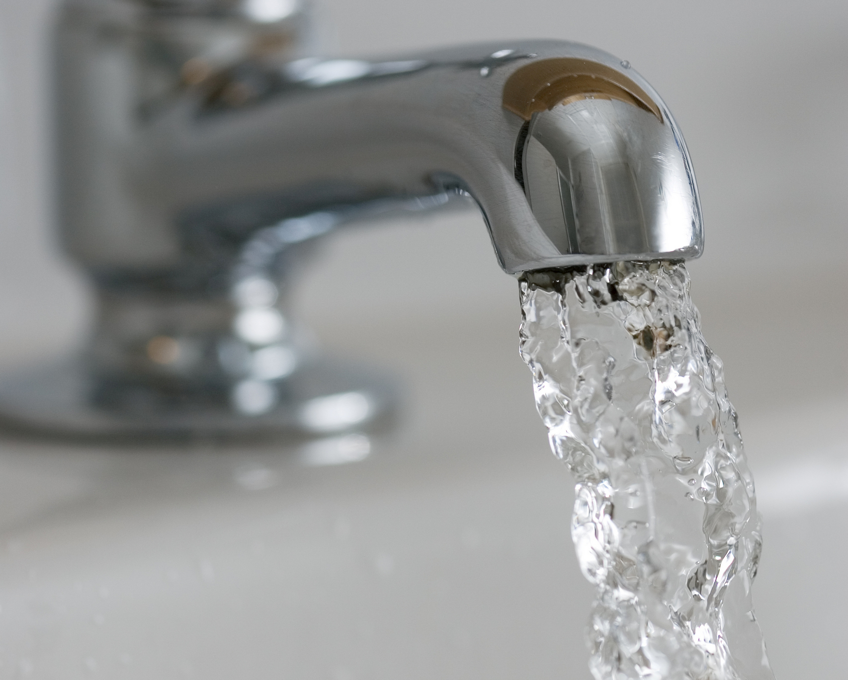 Water flows from a domestic tap, United Kingdom